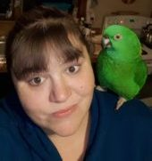 Team member with a green bird on her shoulder